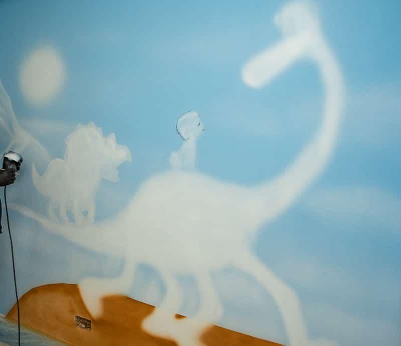 Beginning of hand painted Dino wall mural