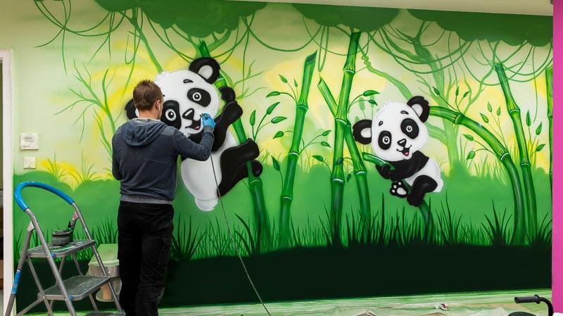 big panda mural with artist