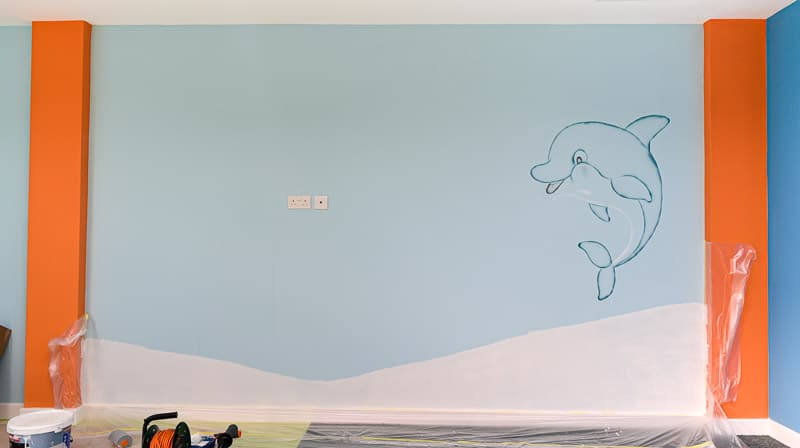 dolphin mural during painting