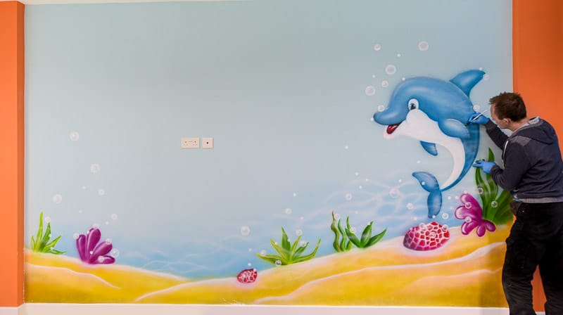 dolphin wall mural painted on the wall