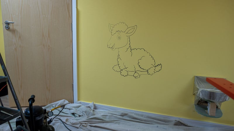 little lamb wall mural while painting