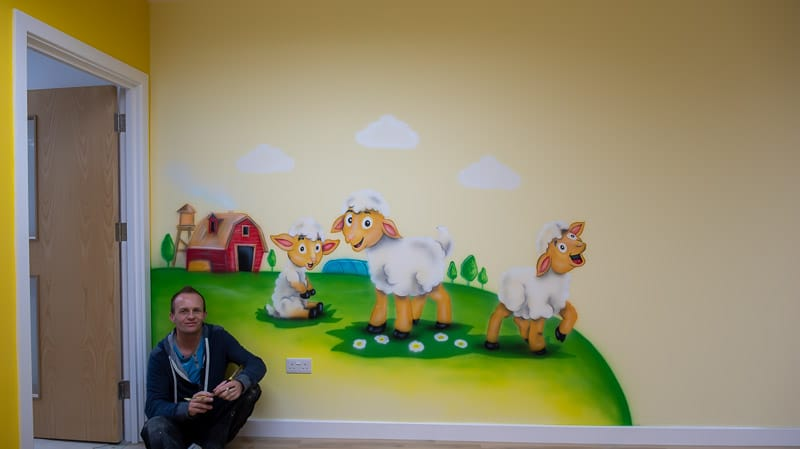little lamb wall mural with muralist