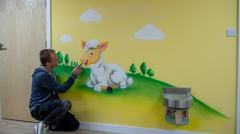 little lamb wall mural with artist
