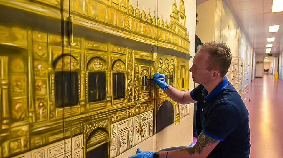 Muralist painting Sikh temple mural