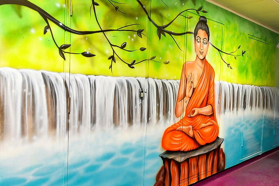 Fabulous meditating Budda mural on the wall