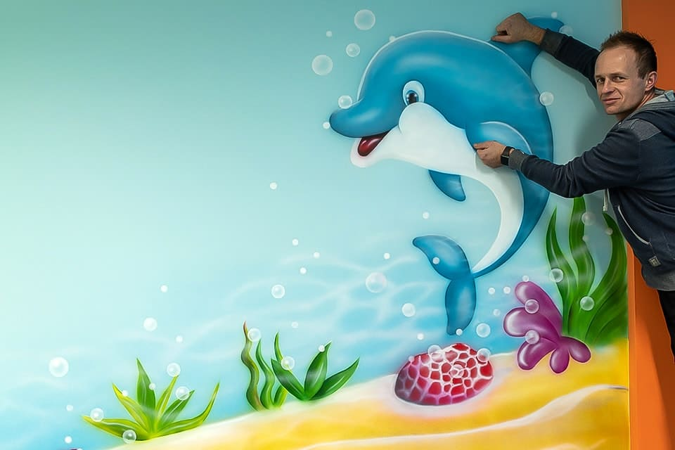 Funny picture of dolphin mural and muralist