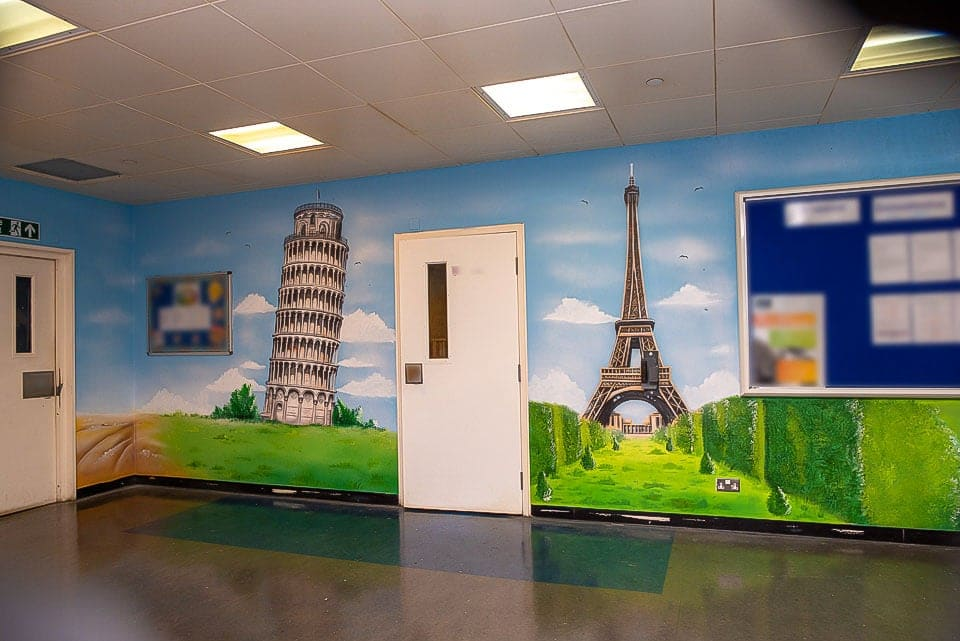 Pisa and Eiffel Tower mural on the wall