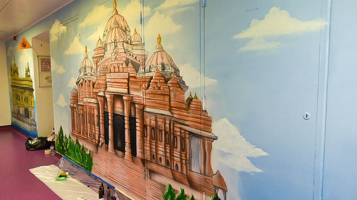 Fabulous gold temple mural on the wall