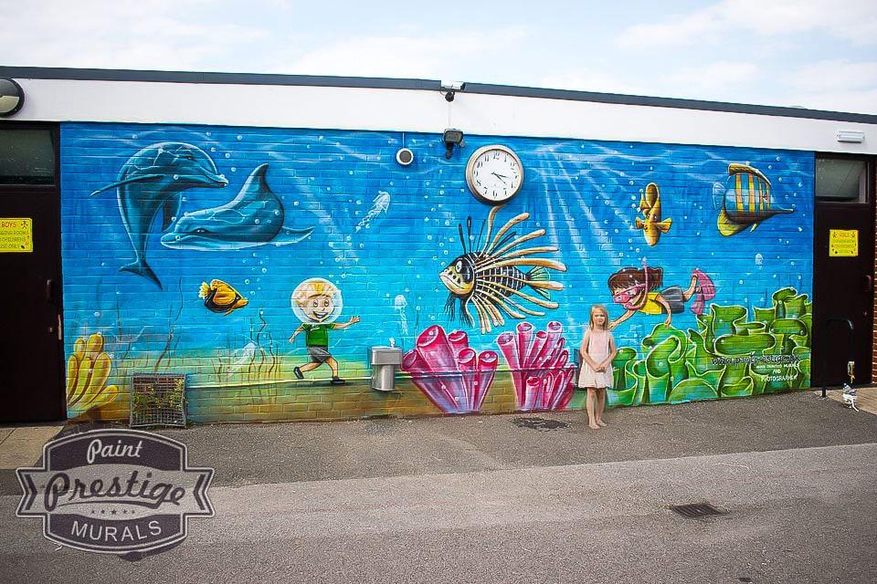 Underwater life mural on outside wall Westlands Primary school