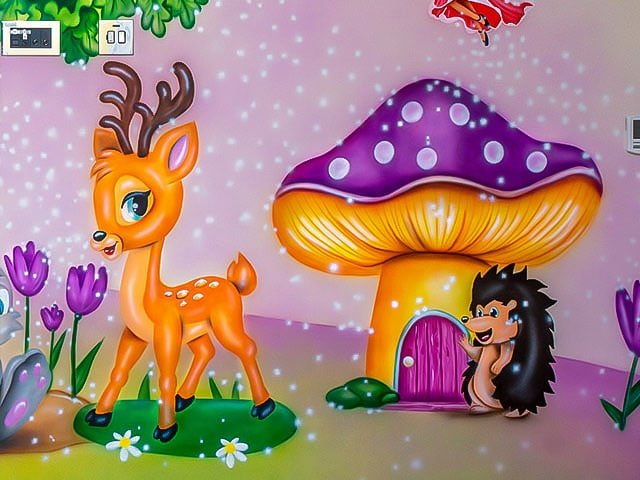 Beautiful mural of fairy tale with mushroom, fawn and hedgehog