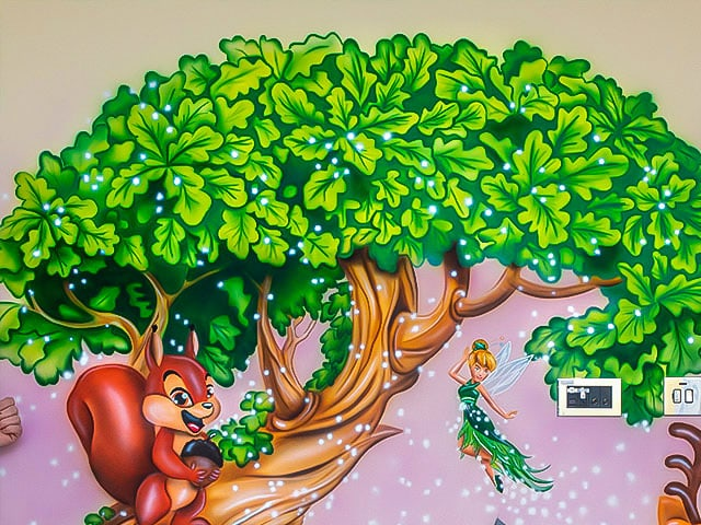 Fantastic mural Tinkerbell and squirrel on the tree background