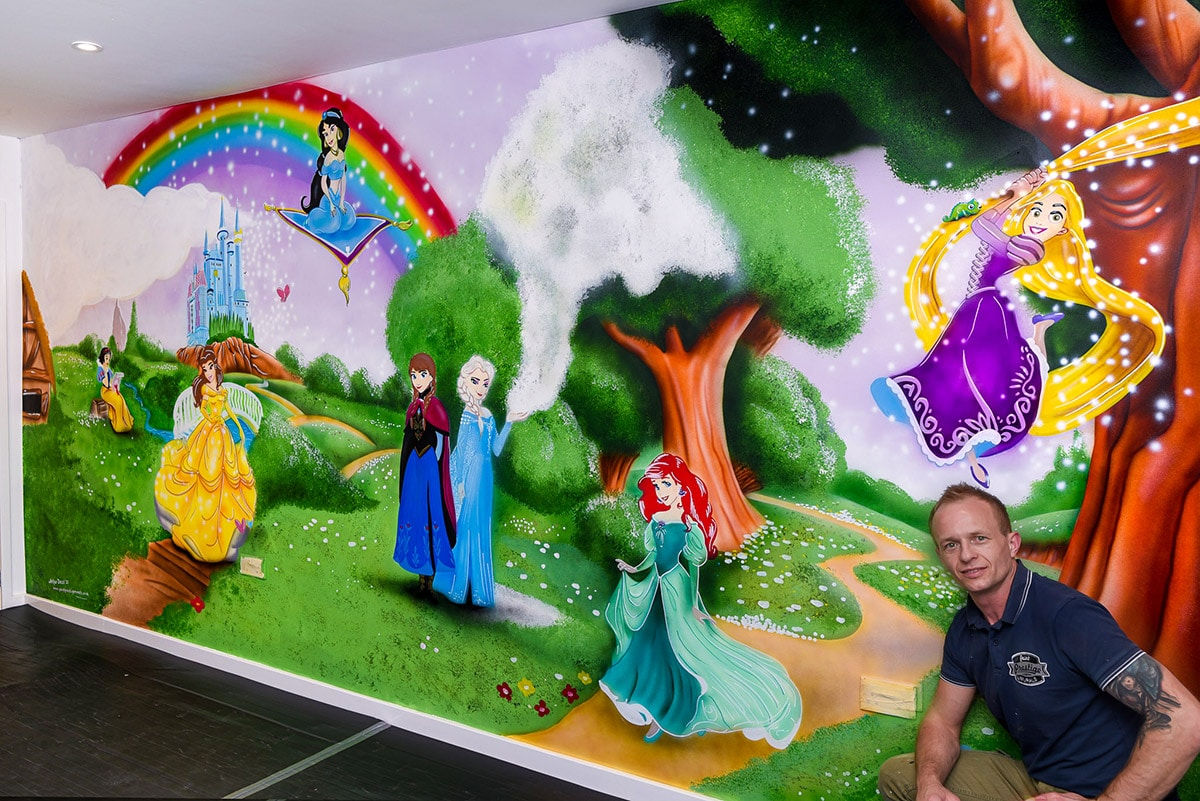 Seven Disney Princess, rainbow and castle wall mural with muralist