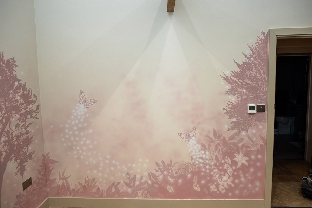 Fabulous pink butterflies on pink trees background wall mural