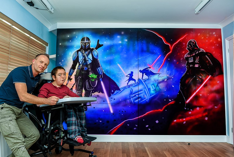 Star Wars mural painted on the wall and artist
