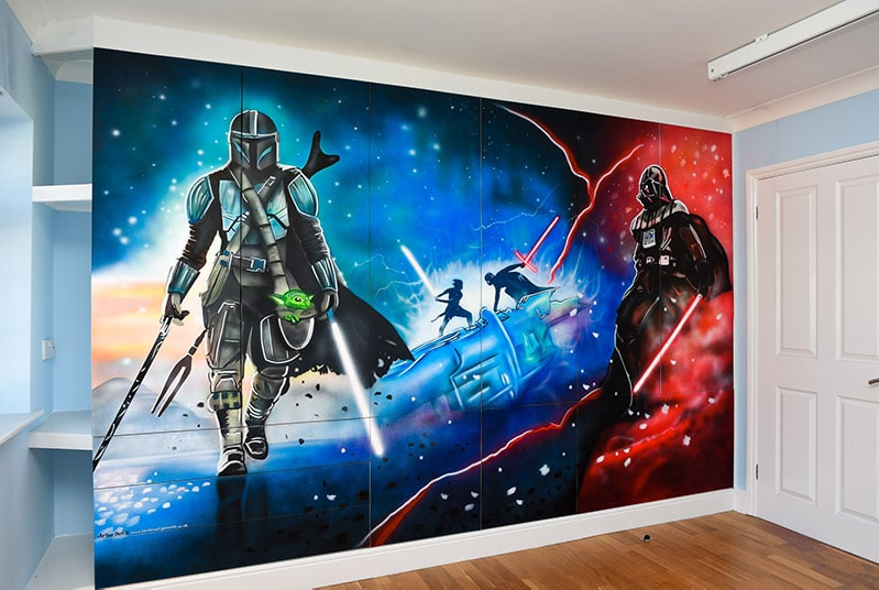 Star Wars mural hand painted on the wall and m