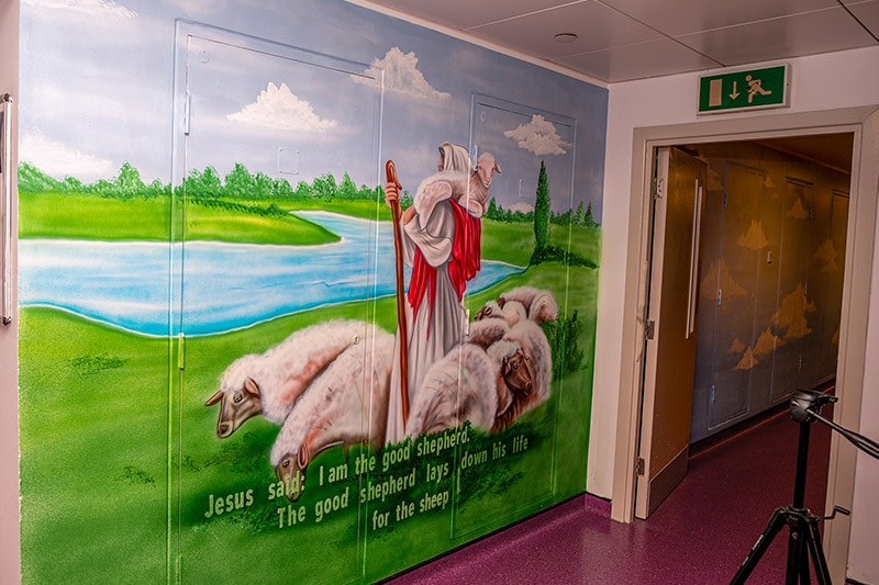 Jesus Christ on the field and river wall mural