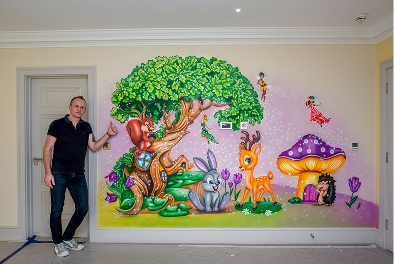 woodland wall mural with mural artist