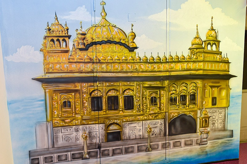 Beautiful golden temple mural on the wall